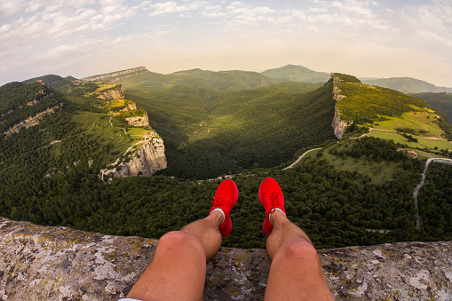 Guy on a stunning viewpoint with nice green canyon formation. - gettyimageskorea