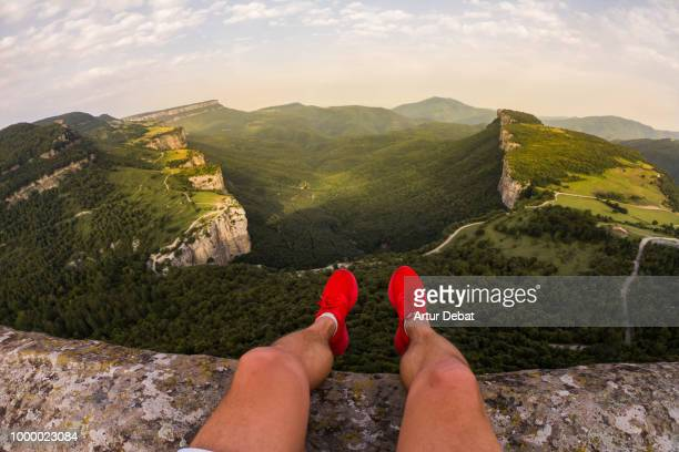 guy on a stunning viewpoint with nice green canyon formation. - high up stock photos and pictures