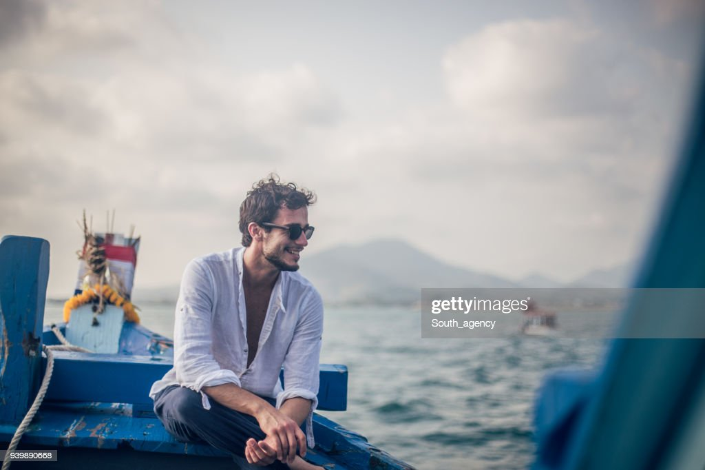 Guy on vacation alone : Stock Photo