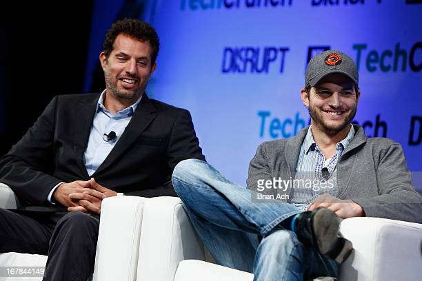 Guy Oseary and Ashton Kutcher of AGrade speak onstage at TechCrunch Disrupt NY 2013 at The Manhattan Center on May 1 2013 in New York City