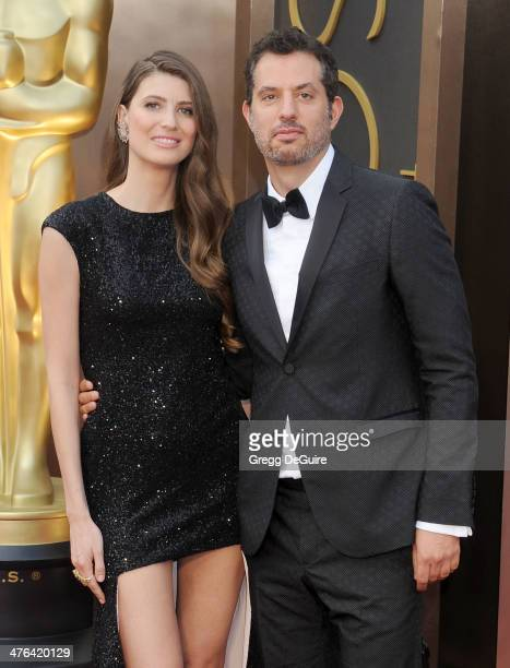 Guy Oseary and Michelle Alves arrive at the 86th Annual Academy Awards at Hollywood Highland Center on March 2 2014 in Hollywood California