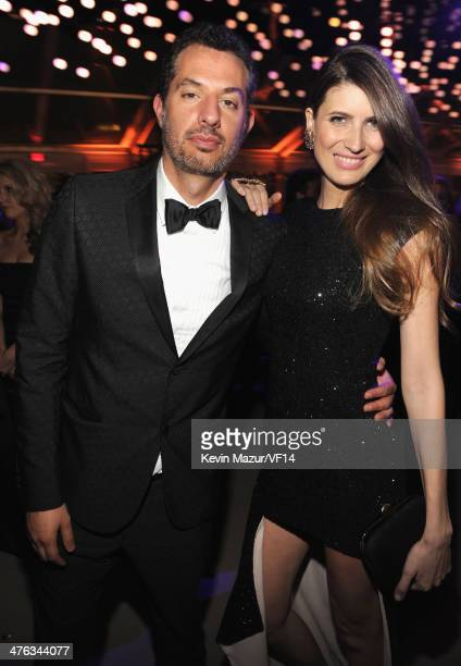 Guy Oseary and Michelle Alves attend the 2014 Vanity Fair Oscar Party Hosted By Graydon Carter on March 2 2014 in West Hollywood California