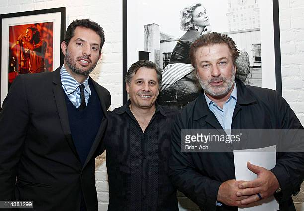 Guy Oseary founder of Rock Paper Photo photographer Kevin Mazur and actor Alec Baldwin attend the launch of RockPaperPhotocom at Private Residence on...