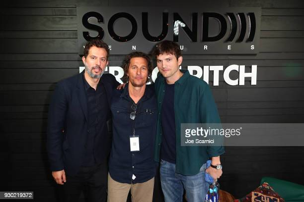 Guy Oseary Matthew McConaughey and Ashton Kutcher pose for a photo at the the Sound Ventures Tech Competition PerfectPitch at SXSW at Hotel Van Zandt...