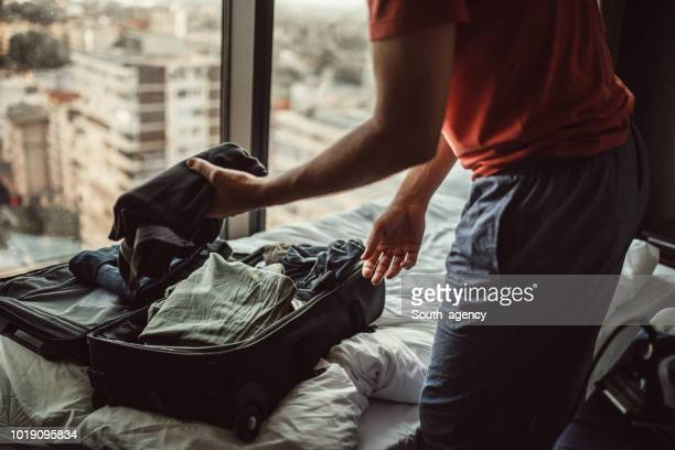 guy packing - unpacking stock pictures, royalty-free photos & images