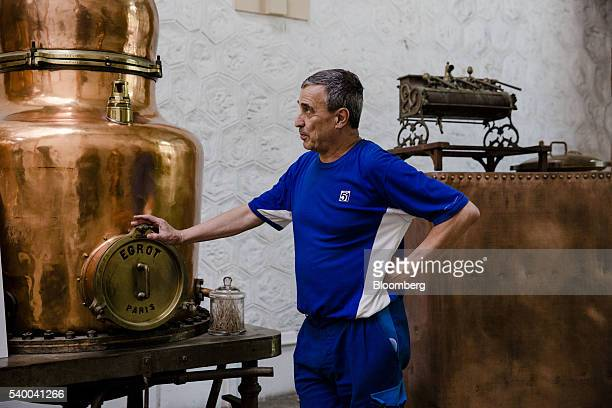 Guy Palmarole a master distiller at Pernod Ricard SA stands beside a vintage alambic still inside Pernod's absinthe distillery in Thuir France on...