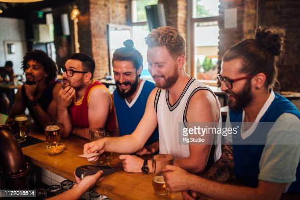 guy paying a bill - charging sports stock pictures, royalty-free photos & images