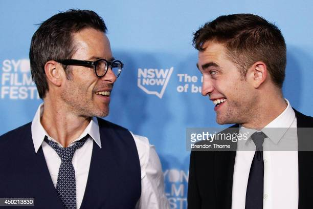 Guy Pearce and Robert Pattinson walk the red carpet at the Australian Premiere of The Rover at the State Theatre on June 7 2014 in Sydney Australia