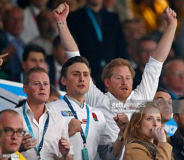 Guy Pelly, Charlie van Straubenzee and Prince Harry attend the England v Australia match during the Rugby World Cup 2015 at Twickenham Stadium on...