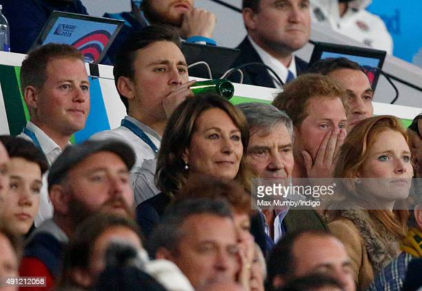 Guy Pelly, Charlie van Straubenzee, Carole Middleton, Michael Middleton and Prince Harry attend the England v Australia match during the Rugby World...