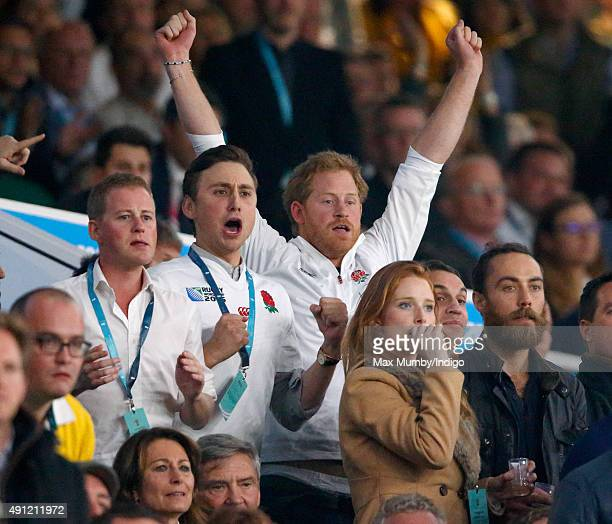 Guy Pelly, Charlie van Straubenzee, Prince Harry and James Middleton attend the England v Australia match during the Rugby World Cup 2015 at...