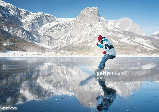 Guy performing a Hockey Stop on Ice, Frozen Lake Grundlsee