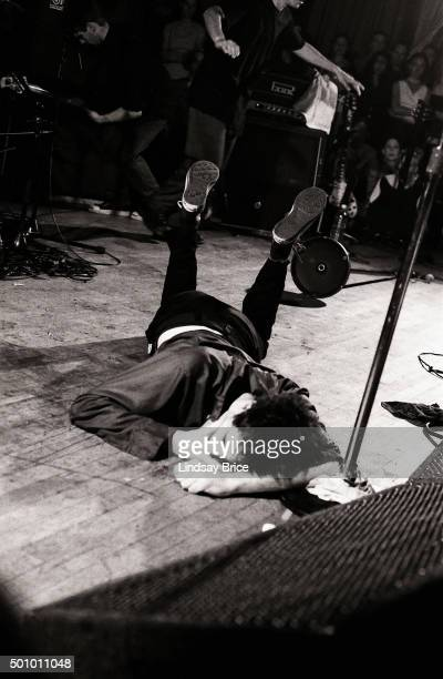 Singer and guitarist Guy Picciotto of the Posthardcore group Fugazi lies on the stage during a concert at The Hollywood Palladium on April 23 1993 in...