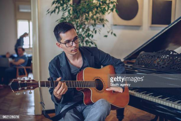 guy playing guitar - deformed hand stock pictures, royalty-free photos & images