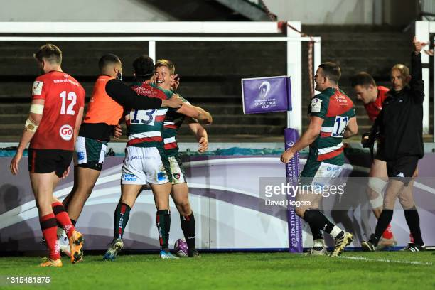 Guy Porter of Leicester Tigers celebrates with teammate Matias Moroni after scoring his team's third try during the European Rugby Challenge Cup...