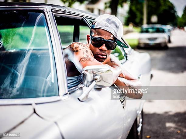 guy posing with his car - rap stock pictures, royalty-free photos & images