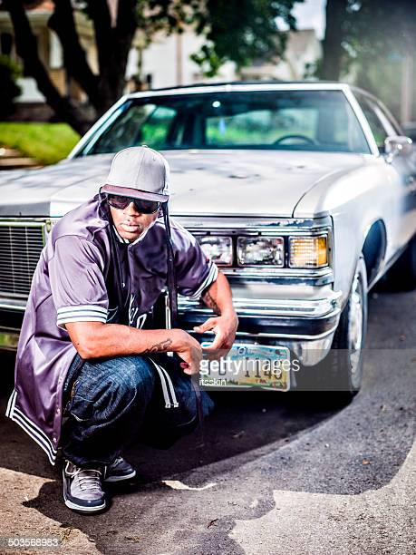 guy posing with his car - hip hop music stock pictures, royalty-free photos & images