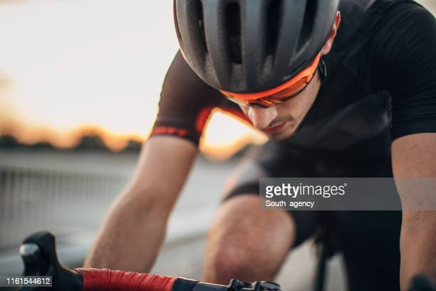 guy racing bicycle rider - racing bicycle stock pictures, royalty-free photos & images