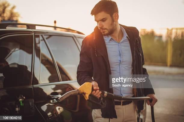 Guy refueling gas tank