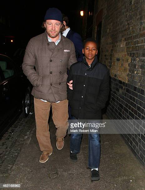 Guy Ritchie and David Banda Mwale Ciccone Ritchie leaving the Chiltern Firehouse on February 10 2015 in London England