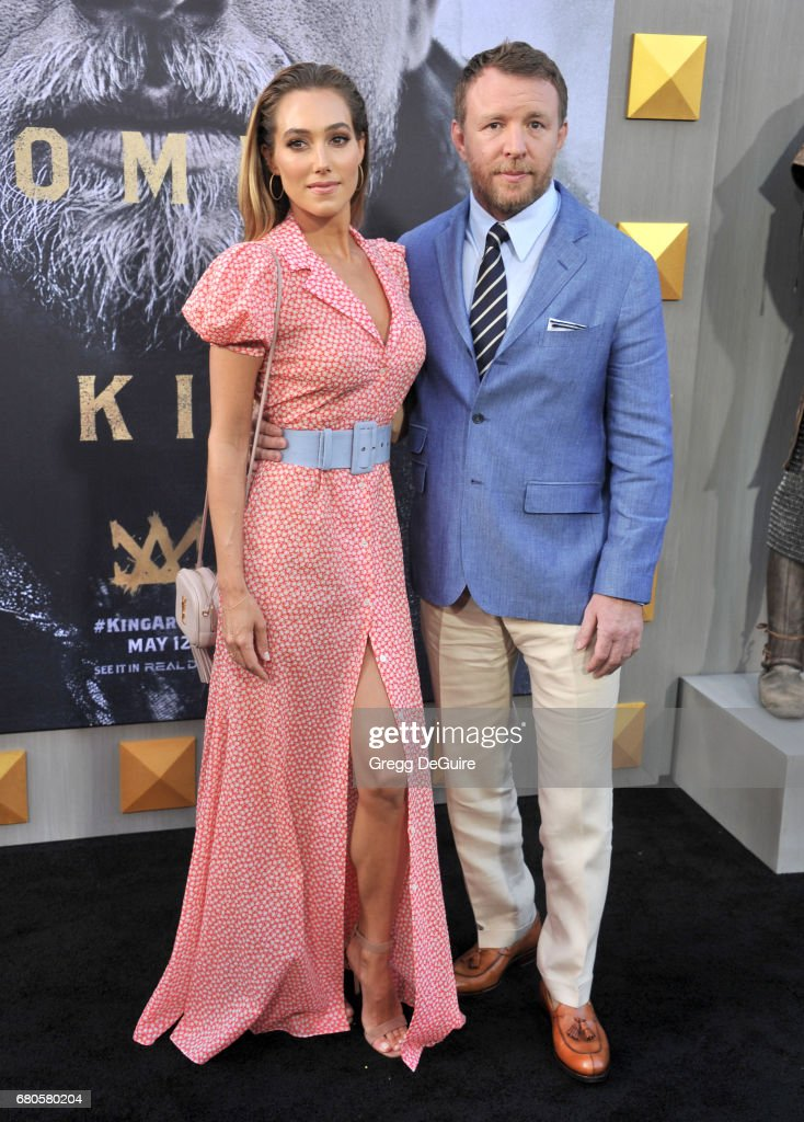 Guy Ritchie and Jacqui Ainsley arrive at the premiere of Warner Bros. Pictures' 'King Arthur: Legend Of The Sword' at TCL Chinese Theatre on May 8, 2017 in Hollywood, California.