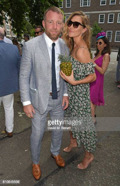 Guy Ritchie and Jacqui Ainsley attend Piers Adam and Sophie Vanacore's wedding at St John's Church on July 7 2017 in London England