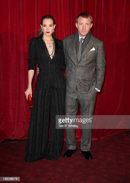 Guy Ritchie and Jacqui Ainsley attend the European film premiere of 'Sherlock Holmes A Game Of Shadows' at Empire Leicester Square on December 8 2011...