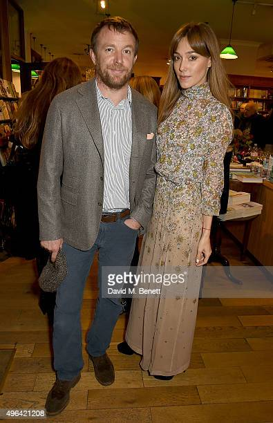 Guy Ritchie and Jacqui Ainsley attend the launch of AA Gill's new book 'Pour Me A Life' at Daunt Books on November 9 2015 in London England