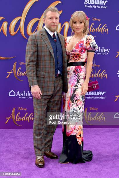 Guy Ritchie and Jacqui Ainsley attend the premiere of Disney's Aladdin at El Capitan Theatre on May 21 2019 in Los Angeles California