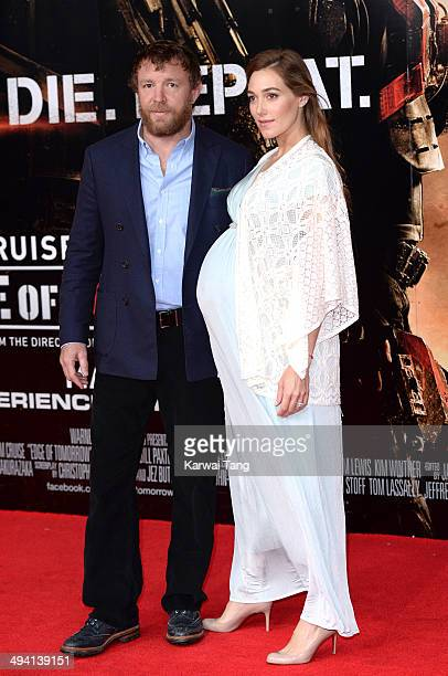 Guy Ritchie and Jacqui Ainsley attend the premiere of 'Edge Of Tomorrow' held at the BFI IMAX on May 28 2014 in London United Kingdom
