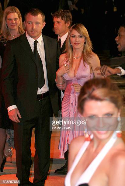 Guy Ritchie and Madonna with Mischa Barton during 2006 Vanity Fair Oscar Party at Morton's in West Hollywood California United States