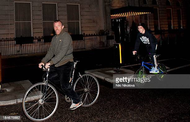 Guy Ritchie and son Rocco Ritchie sighted on bicycles on October 14 2013 in London England
