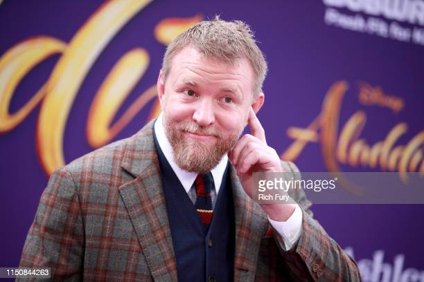 Guy Ritchie attends the premiere of Disney's Aladdin on May 21 2019 in Los Angeles California