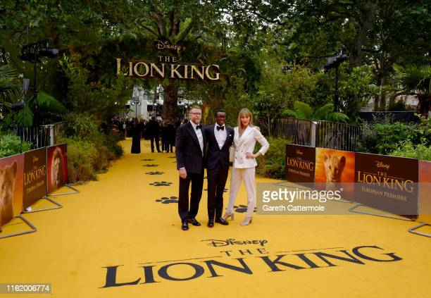 """Guy Ritchie, David Banda Mwale Ciccone Ritchie and Jacqui Ainsley attend the European Premiere of Disney's """"The Lion King"""" at Odeon Luxe Leicester..."""