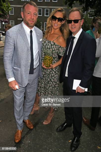 Guy Ritchie Jacqui Ainsley and Geordie Greig attend Piers Adam and Sophie Vanacore's wedding at St John's Church on July 7 2017 in London England