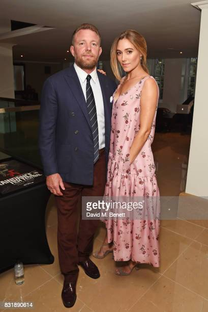 Guy Ritchie winner of the Auteur Award and wife Jacqui Ainsley attend the Raindance Film Festival anniversary drinks reception at The Mayfair Hotel...