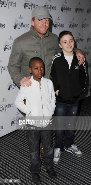 Guy Ritchie with David Banda and Rocco Ritchie attend the grand opening of Warner Bros Studio Tour London at Leavesden Studios on March 31 2012 in...