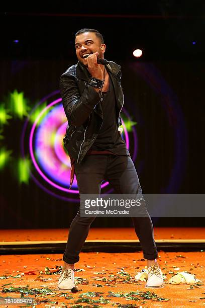 Guy Sebastian performs during the Nickelodeon Slimefest 2013 evening show at Sydney Olympic Park Sports Centre on September 27, 2013 in Sydney,...