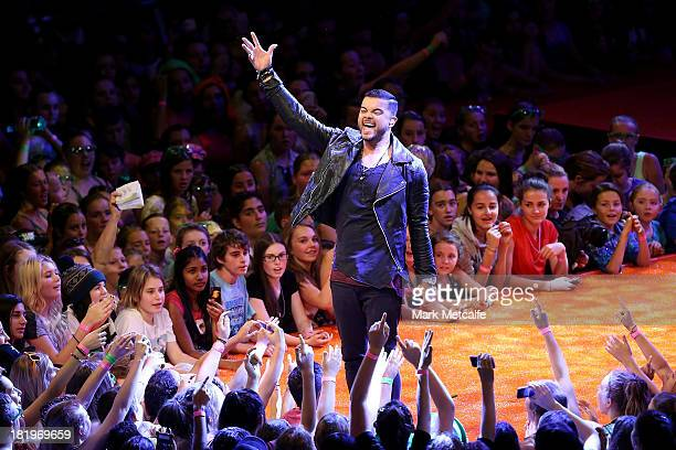 Guy Sebastian performs during the Nickelodeon Slimefest 2013 matinee show at Sydney Olympic Park Sports Centre on September 27, 2013 in Sydney,...