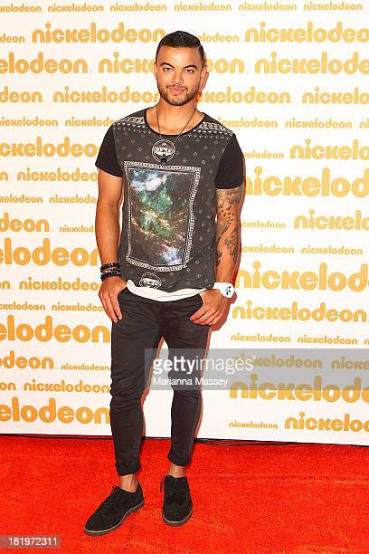 Guy Sebastian poses on the media wall ahead of the Nickelodeon Slimefest 2013 matinee show at Sydney Olympic Park Sports Centre on September 27, 2013...