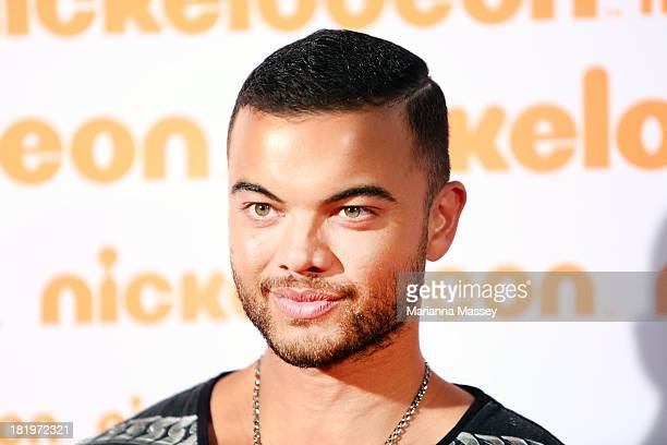 Guy Sebastian poses on the media wall ahead of the Nickelodeon Slimefest 2013 matinee show at Sydney Olympic Park Sports Centre on September 27 2013...