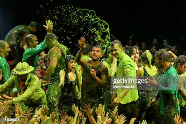 Guy Sebastian throws slime into the crowd during the Nickelodeon Slimefest 2013 evening show at Sydney Olympic Park Sports Centre on September 27,...