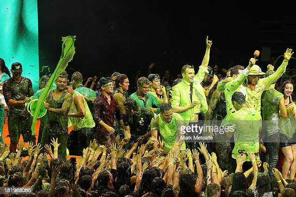 Guy Sebastian throws slime into the crowd during the Nickelodeon Slimefest 2013 evening show at Sydney Olympic Park Sports Centre on September 27...