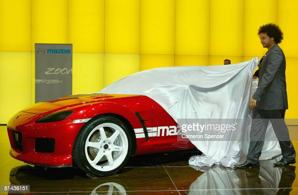 Guy Sebastian unveils a Mazda RX8 turbo concept car during the Australian International Motorshow at the Darling Harbour Convention Centre October 7...