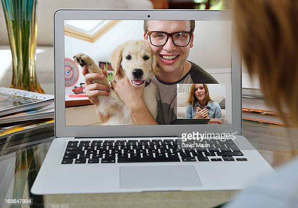 Guy showing off his new puppy over Skype.