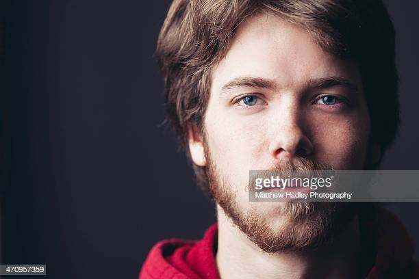 guy smirking high contrast on black - smirking stock pictures, royalty-free photos & images