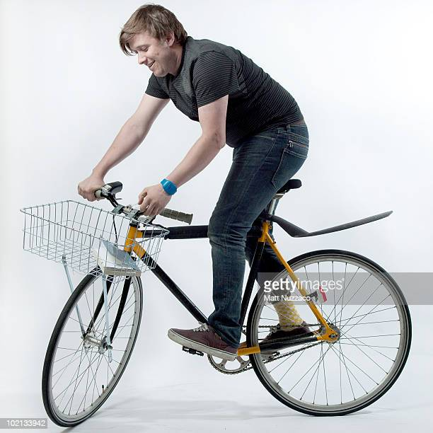 Guy standing on a bicycle