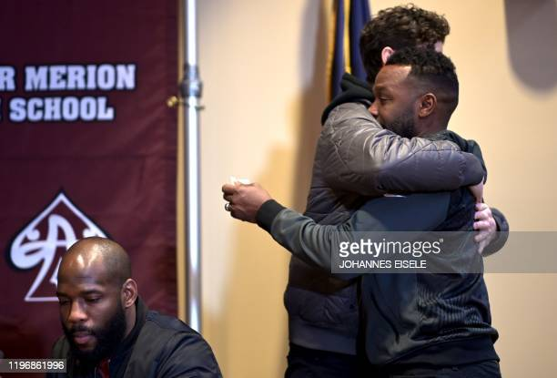 Guy Stewart a friend of Kobe Bryant is hugged by a student after a press conference at Lower Merion High School where basketball legend Kobe Bryant...