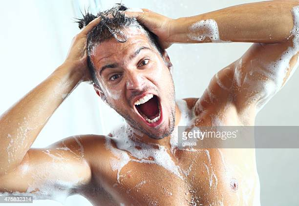 Guy taking a shower and suddenly soap meets his eyes.
