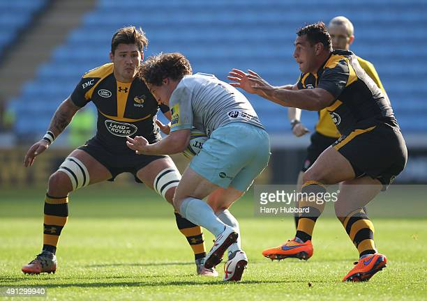 Guy Thompson of Wasps and Jamie Elliott of Northampton Saints and George Smith of Wasps in action during the pre season friendly match between Wasps...